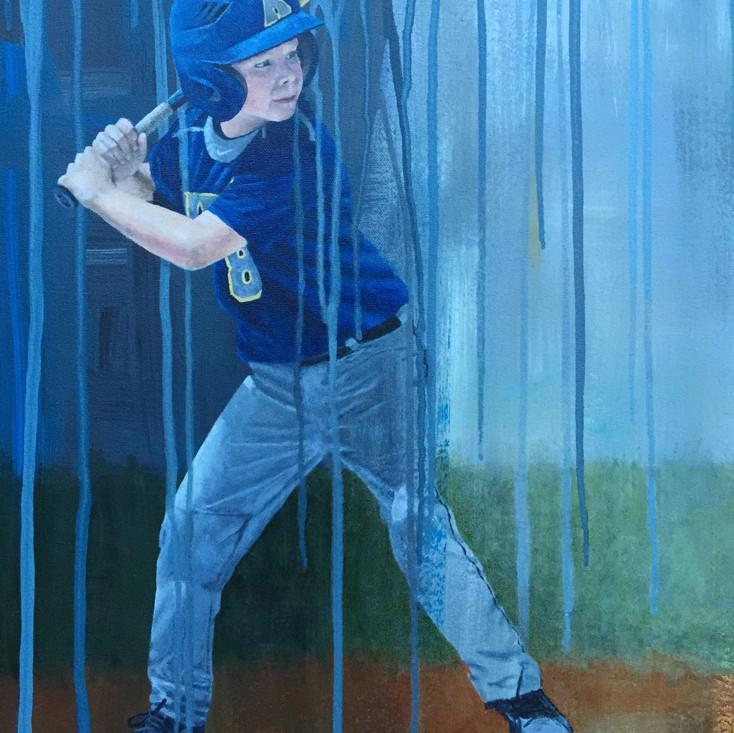child baseball player at bat