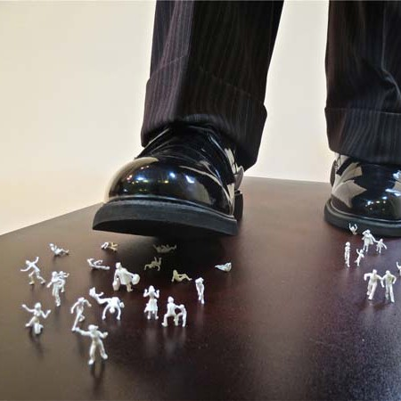 Shoe stomping on miniature people