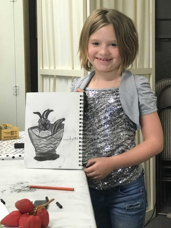 youth showing drawing she did