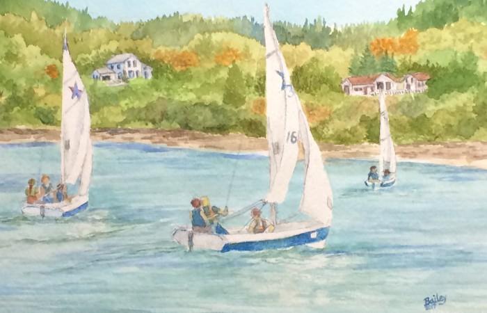 three boats sailing