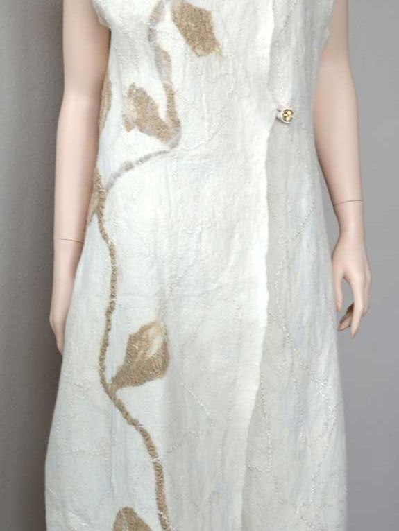 long white sleeveless coat