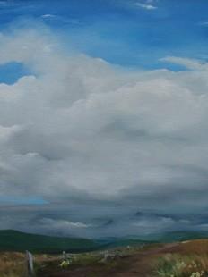 Clouds over hillside