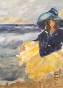 girl with yellow dress and hat on the beach