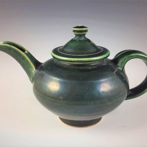 stylized teapot with lid in blue