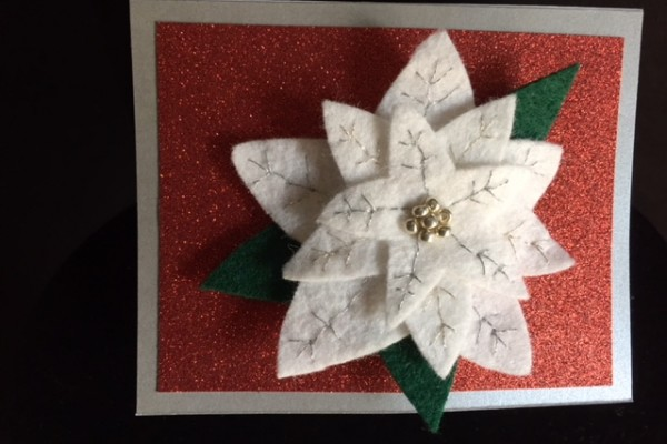 Pin in pointsettia shape made of felt