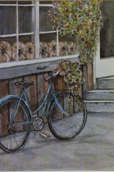 bakery front wiht bicycle with flowers