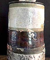 tall clay vessel with lid