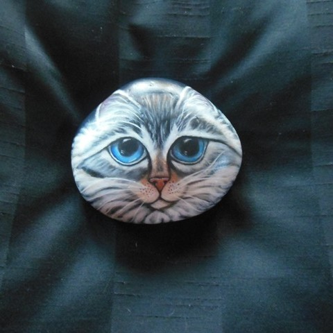 cat face painted on a rock