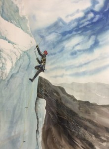 Climber on snow covered cliff
