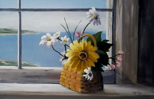 window with flowers looking to the ocean