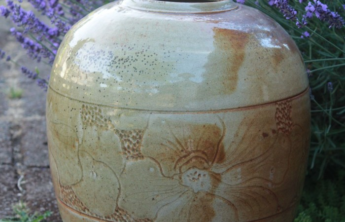white clay vessel with carving