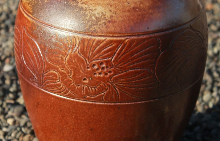 Large carved clay vessel