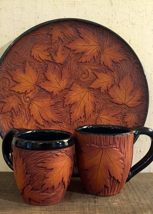 plate and mugs with leaf design