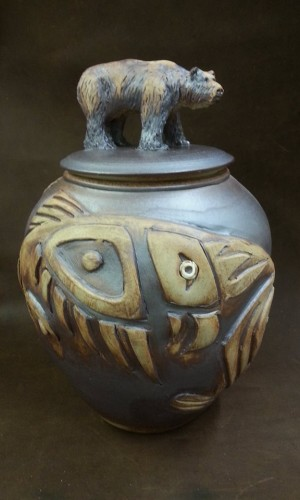 bear and fish images sculpted on urn