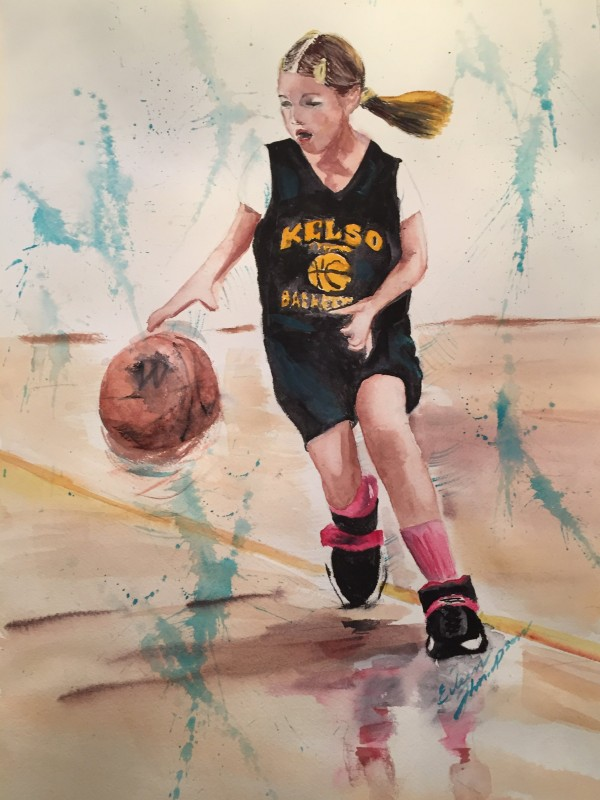 young female basketball player dribbling the ball