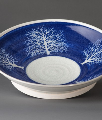 footed dish with tree design