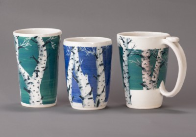 Blue and green tree designs on coffee mugs