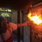 artist working with firing kiln