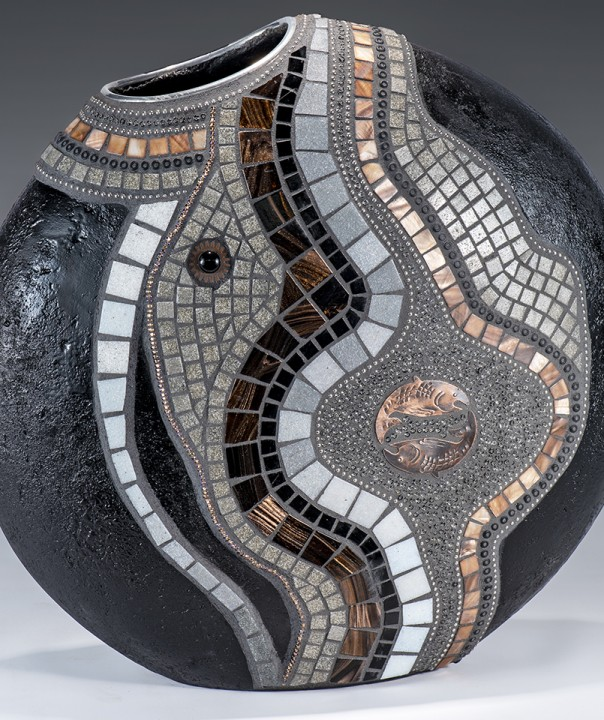 vase with a design in black, white and copper colors