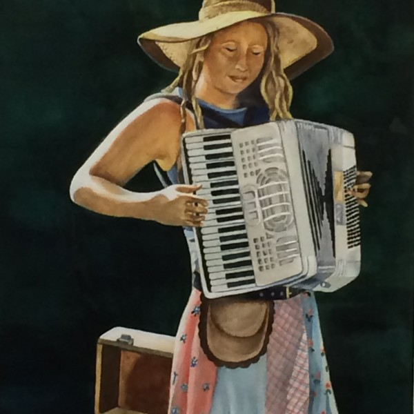 female teen playing an accordian