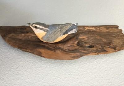 carved wren on wood