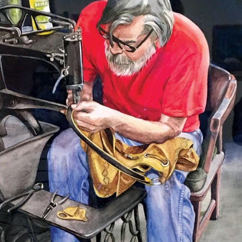 man sewing a leather purse