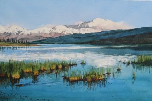 mountain scene with water amd reeds in the water