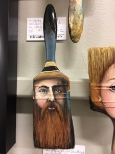 image of a man wearing a hat on a paint brush