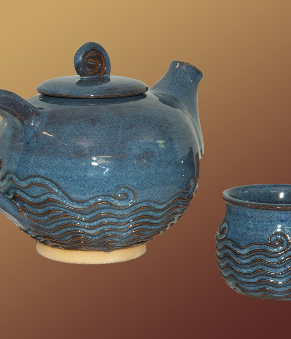 blue colored tea pot with texture