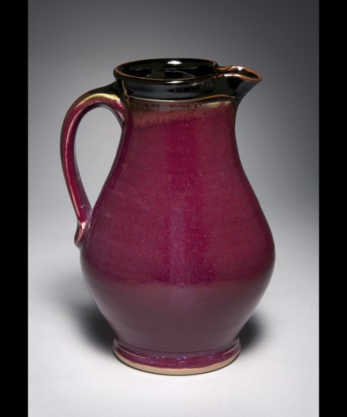 pitcher with red outside and black inside