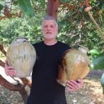 artist holding 2 large vessels