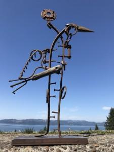 vertical image of a bird meade of metal