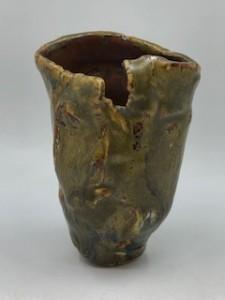 Green glazed vessel like a flower