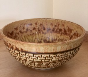 gold bowl with basket weave look