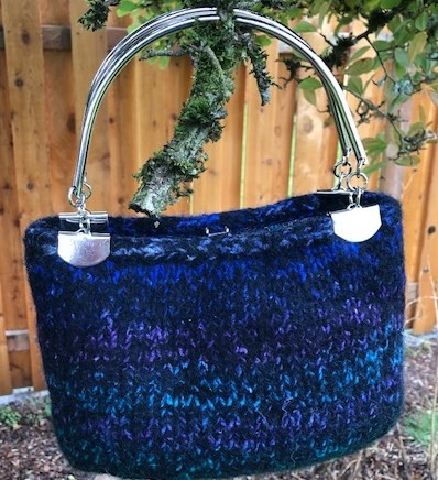 Felted purse with metal handle