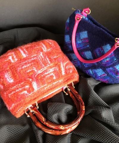 orange print cloth purse and blue print cloth purse with 2 handles
