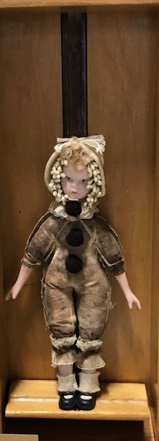 doll with vintage clothing