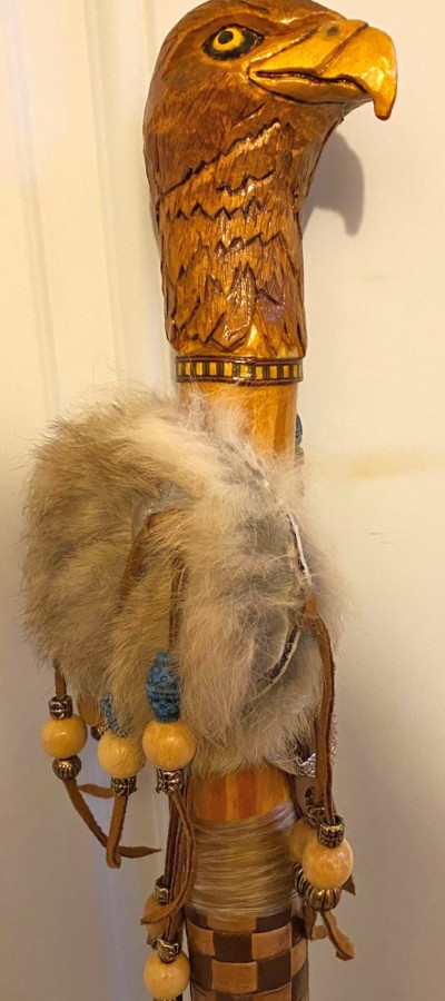 carved eagle with feathers and leather