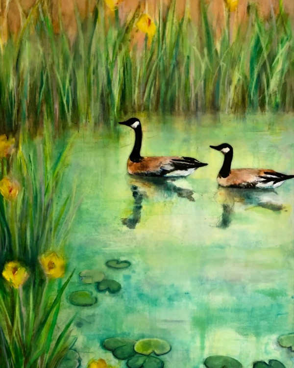 2 geese on the water by reeds