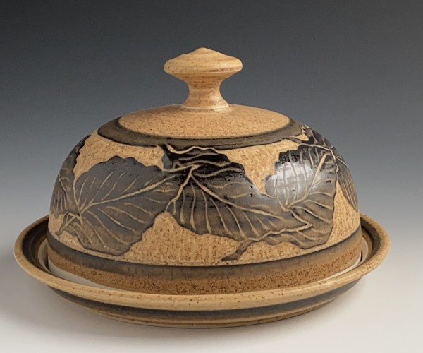 covered dish with leaf design