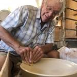 artist at potter's wheel